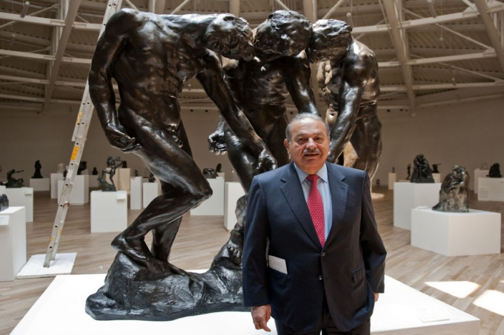 Mexican tycoon Carlos Slim poses in fron
